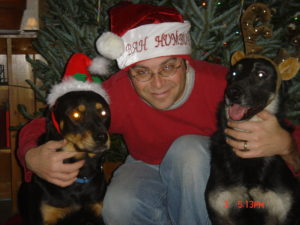 Todd and dogs in front of christmas tree